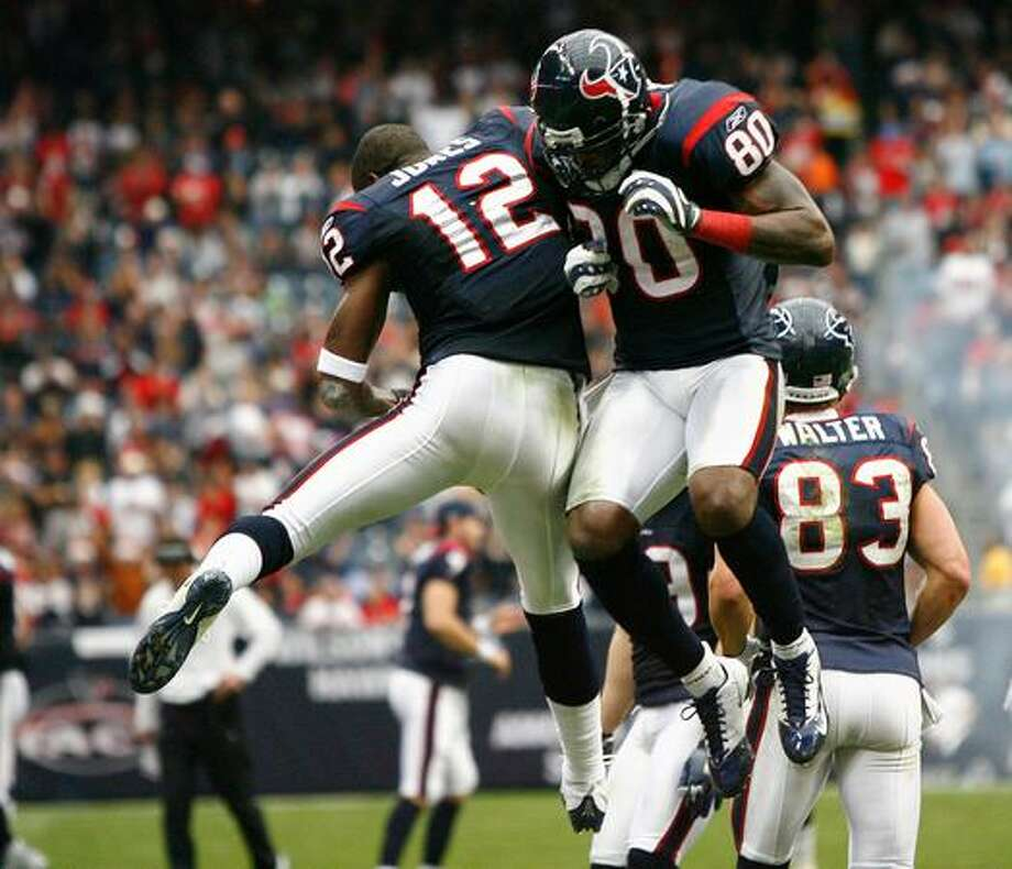 Houston Texans wide receiver Jacoby Jones (12), left, celebrates after wide receiver Andre Johnson (80) scored his second touchdown in the second quarter. Photo: Houston Chronicle / Houston Chronicle