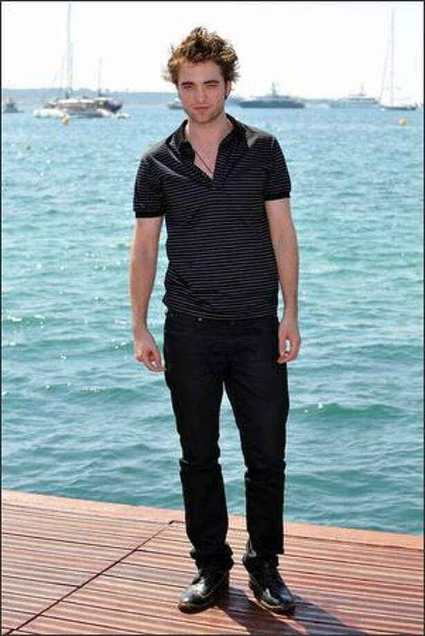 Robert Pattinson poses for a picture as he attends a photocall held at the Majestic Beach Pier -- La Croisette during the 62nd International Cannes Film Festival in Cannes, France, on Tuesday, May 19, 2009. Photo: Getty Images / Getty Images