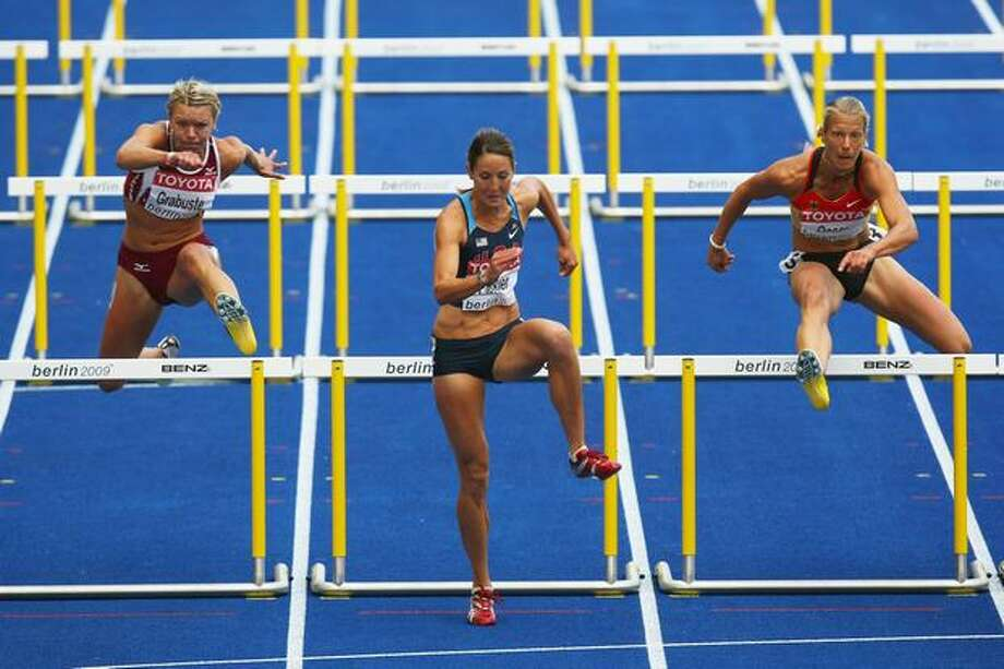 (L-R) Aiga Grabuste of Latvia, Diana Pickler of United States and Jennifer Oeser of Germany compete in the women's heptathlon (100-meter hurdles) during day one of the 12th IAAF World Athletics Championships at the Olympic Stadium in Berlin, Germany on Saturday, Aug. 15, 2009. Photo: Getty Images / Getty Images