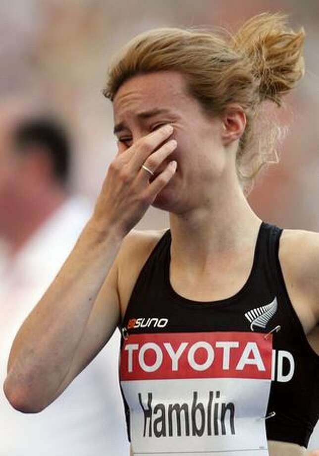Nikki Hamblin of New Zealand cries after competing in the women's 800 Metres Heats during day two of the 12th IAAF World Athletics Championships at the Olympic Stadium on Sunday in Berlin, Germany. Photo: Getty Images / Getty Images