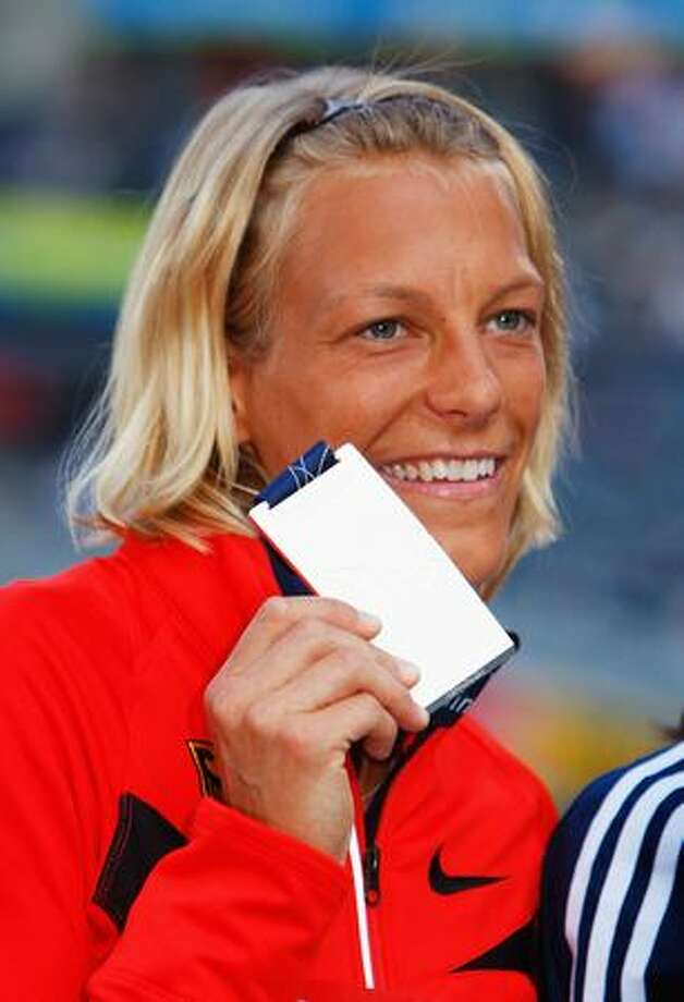 Jennifer Oeser of Germany receives the silver medal during the medal ceremony for the women's Heptathlon during day three of the 12th IAAF World Athletics Championships at the Olympic Stadium in Berlin, Germany. Photo: Getty Images / Getty Images