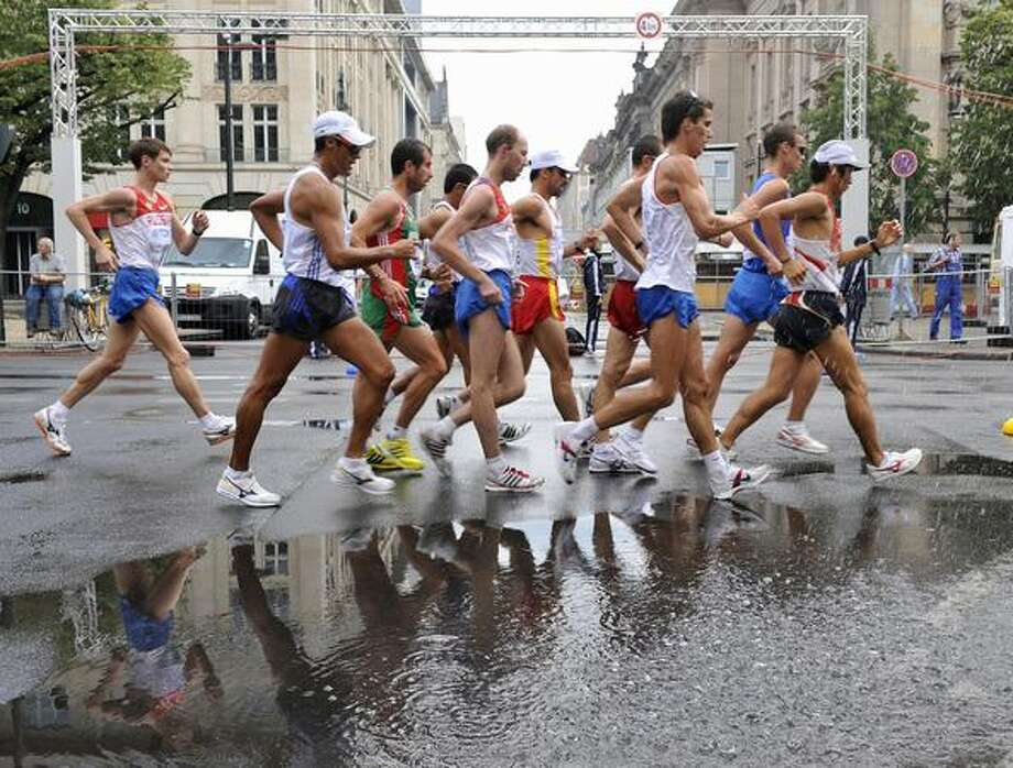 Athetes compete in the men's 50 km walk of the 2009 IAAF Athletics World Championships on August 21, 2009 in Berlin. Photo: Getty Images / Getty Images