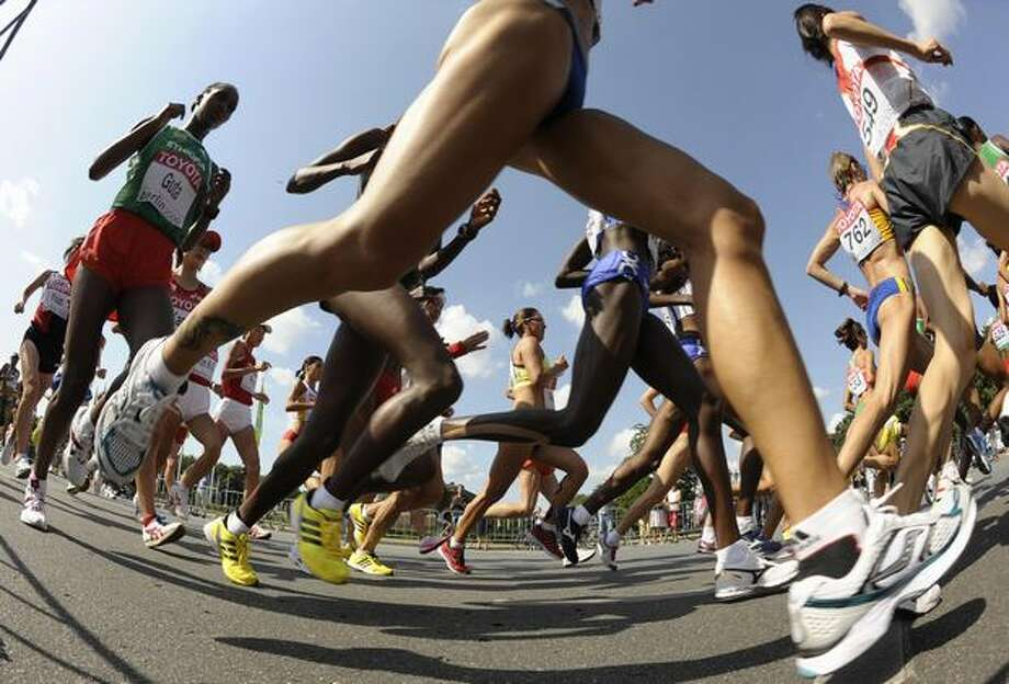 Athletes compete in the women's marathon of the 2009 IAAF Athletics World Championships on Sunday in Berlin. Photo: Getty Images / Getty Images