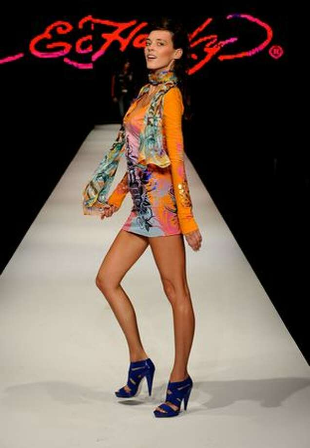 A model showcases designs on the catwalk during the Ed Hardy Group Show at Rosemount Sydney Fashion Festival 2009 at Martin Place Collection Showroom on Friday in Sydney, Australia. Photo: Getty Images / Getty Images