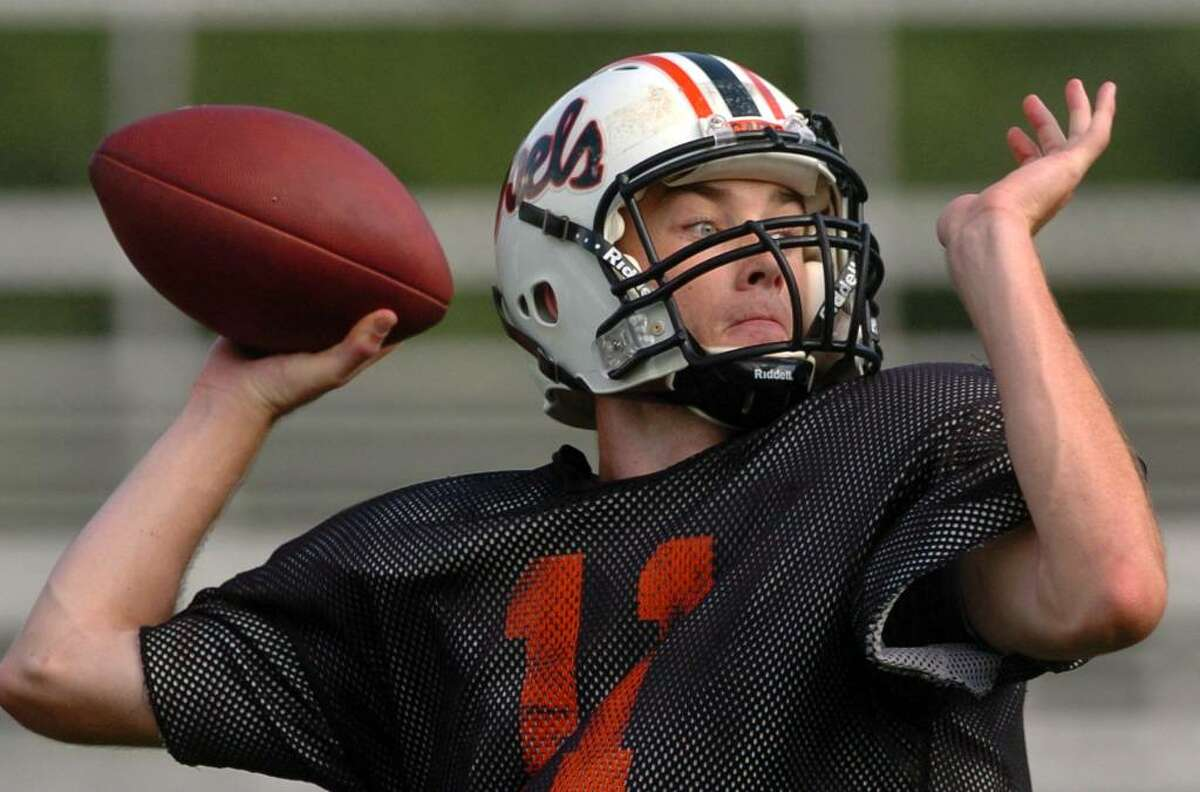 Shelton QB Ryan Pendagast throws a pass during team practice in Shelton, Conn. on Wednesday Sept. 23, 2009.