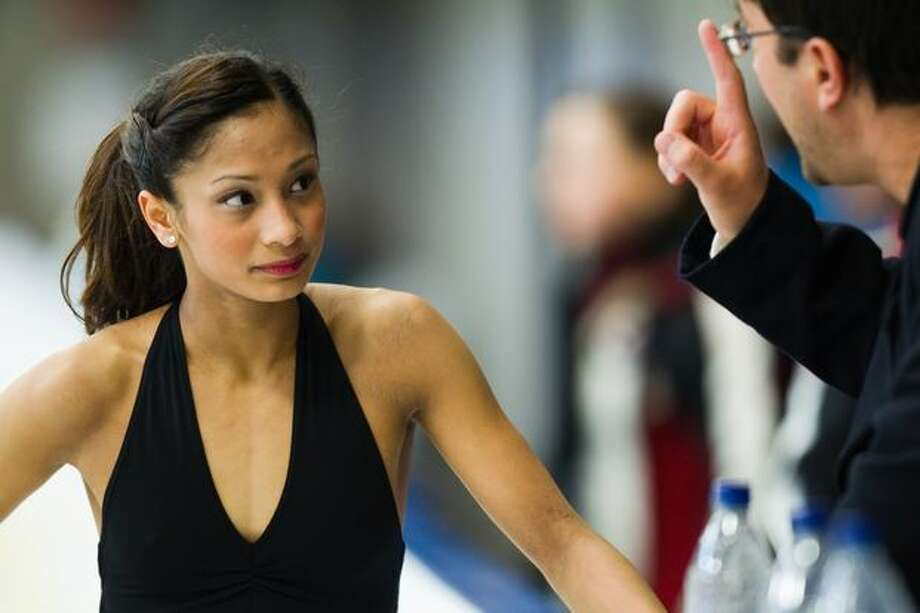 US pairs figure skater Amanda Evora confers with coach Jim Peterson as she trains at the Trout Lake Community Centre. Photo: Smiley N. Pool, Hearst Newspapers / Hearst Newspapers