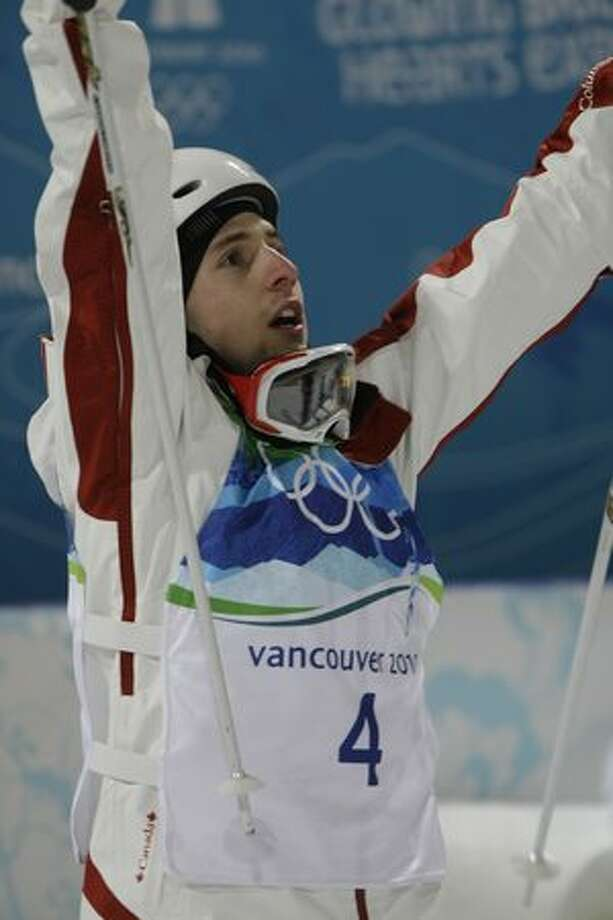 Canadian freestyle skier Alexandre Bilodeau reacts as his winning score of 26.75 is posted on the screen. Bilodeau made history by winning the first Olympic gold medal for Canada on home soil at the men's moguls finals at Cypress Mountain on Sunday. Photo: Hearst Newspapers / Hearst Newspapers