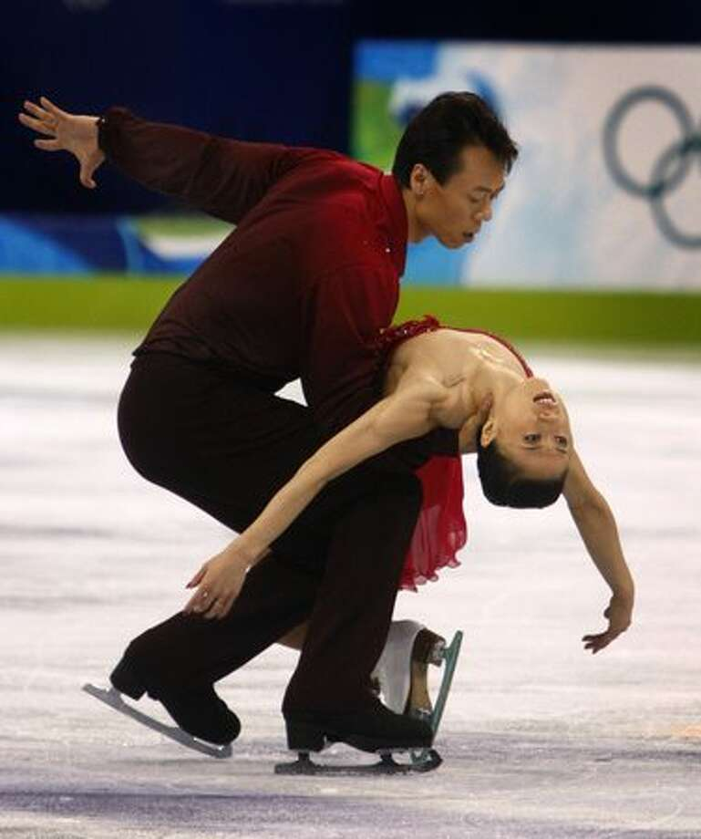 Xue Shen (right) and Hongbo Zhao of China perform their gold medal-winning program in the pairs free skate competition at the Winter Olympic Games in Vancouver, British Columbia, on Monday, Feb. 15, 2010..Paul Chinn/Chronicle Olympic Bureau Photo: Hearst Newspapers / Hearst Newspapers