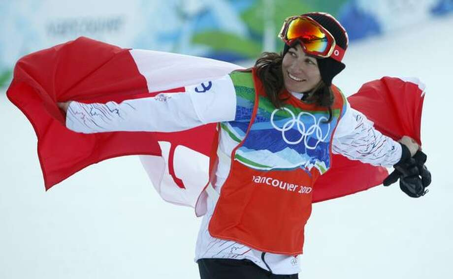 Maelle Ricker of Canada waves the national flag to a partisan crowd after winning the gold medal in the women's snowboard cross competition in the Winter Olympic Games at Cypress Mountain in West Vancouver, British Columbia, on Tuesday, Feb. 16, 2010..Paul Chinn/Chronicle Olympic Bureau Photo: Hearst Newspapers / Hearst Newspapers