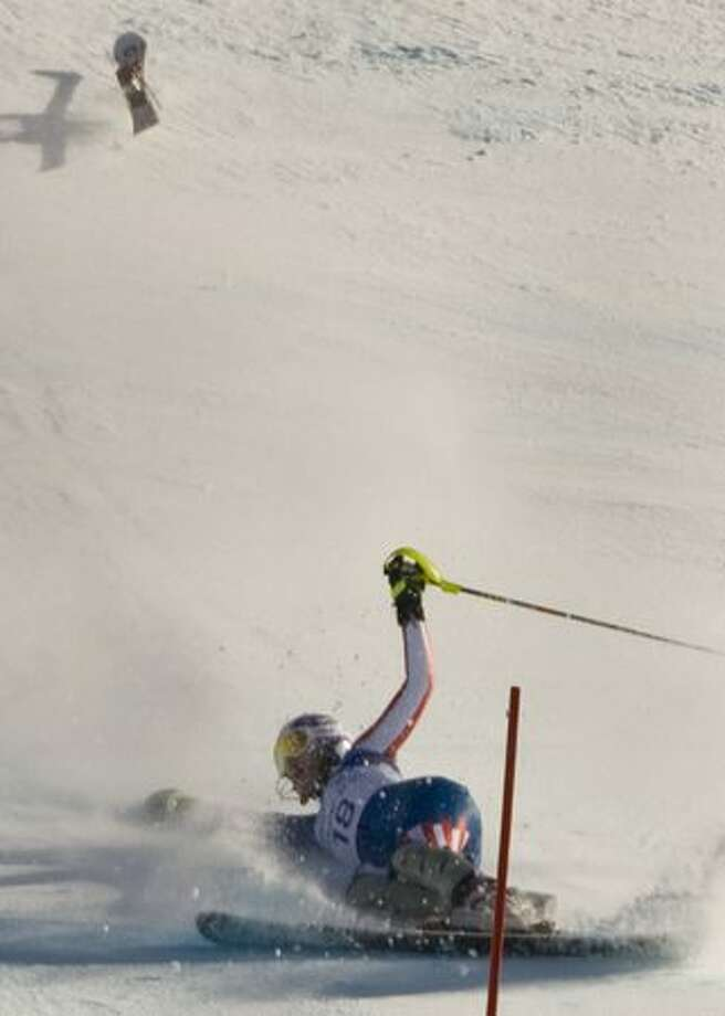 Lindsey Vonn falls during the slalom portion of the womens super combined event at Whistler Creekside at the 2010 Winter Olympic Games on Thursday, Feb. 18, 2010, in Vancouver. ( Jay Hu / For the Houston Chronicle ). Photo: Hearst Newspapers / Hearst Newspapers
