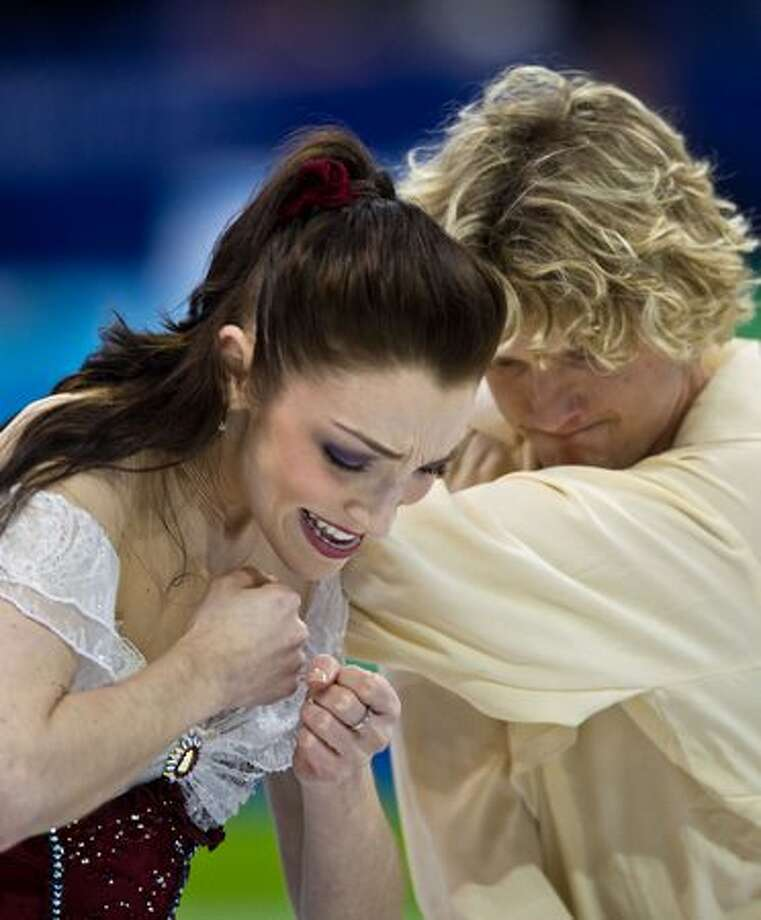 Meryl Davis and Chalie White of the USA perform during the ice dancing free skate at the 2010 Winter Olympics on Monday, Feb. 22, 2010, in Vancouver. ( Smiley N. Pool / Houston Chronicle) Photo: Hearst Newspapers / Hearst Newspapers