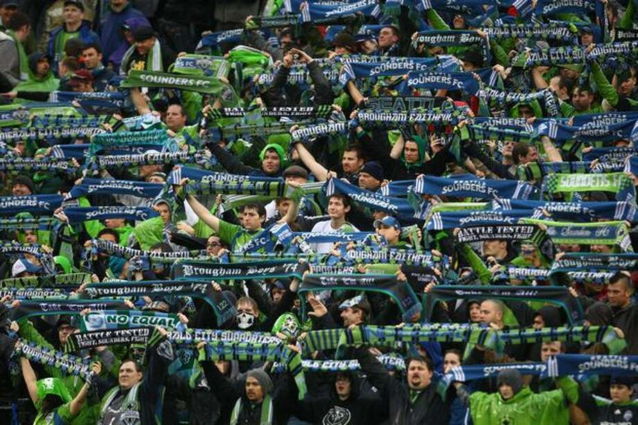Seattle Sounders fans cheer on their team against the Philadelphia Union at Qwest Field in Seattle on Thursday, March 25, 2010. Photo: Joshua Trujillo, Seattlepi.com / seattlepi.com