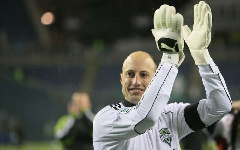 Sounders goalkeeper Kasey Keller cheers with fans after defeating the Philadelphia Union. Photo: Joshua Trujillo, Seattlepi.com / seattlepi.com