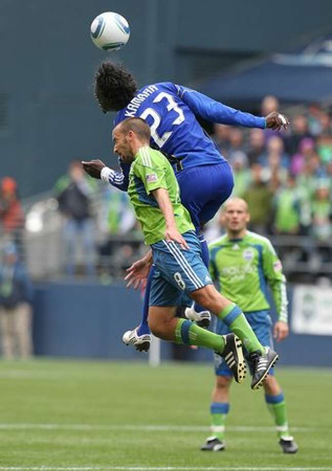 Peter Vagenas #8 of the Seattle Sounders FC battles Kei Kamara #23 of the Kansas City Wizards on April 17, 2010 at Qwest Field in Seattle, Washington. Photo: Getty Images / Getty Images