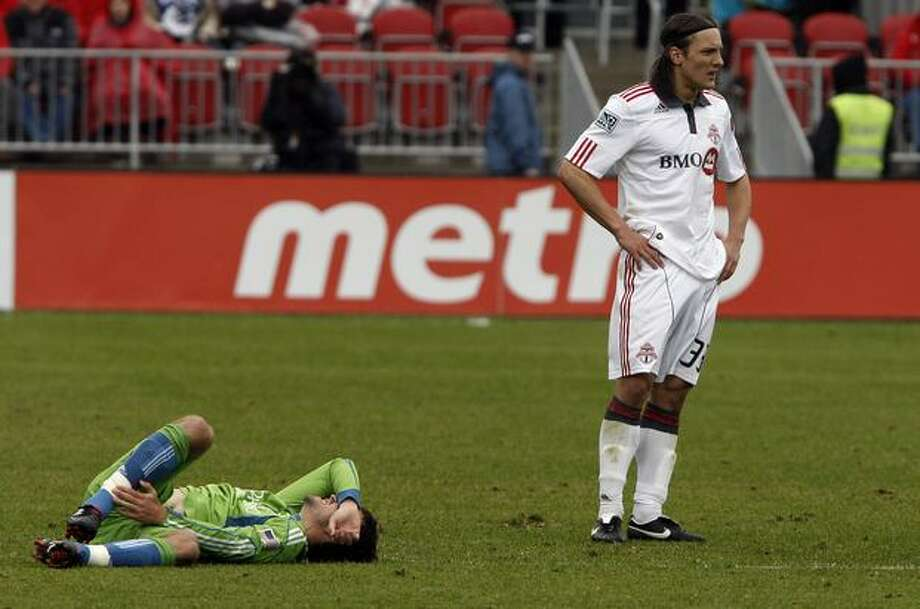 Maksim Usanov #33 of Toronto FC walks away from an injured Nathan Sturgis #12 of the Seattle Sounders FC during an MLS game at BMO Field in Toronto on Sunday, April 25, 2010. Photo: Getty Images / Getty Images