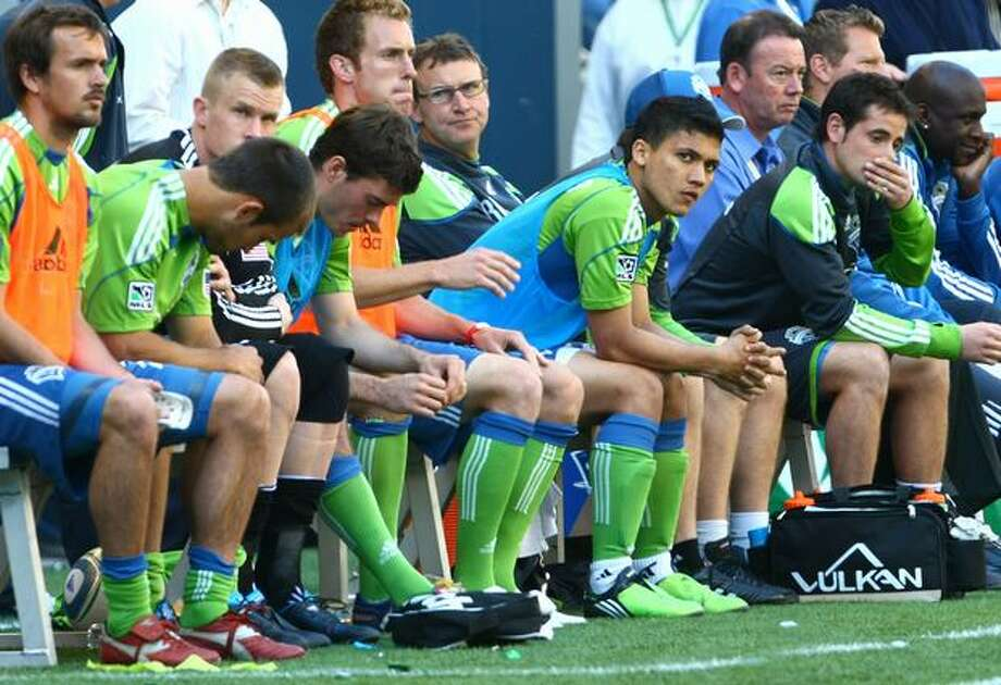 The Seattle Sounders bench watches the second half of the game unfold against the Los Angeles Galaxy  in a 4-0 loss at Qwest Field. Photo: Joshua Trujillo, Seattle Post-Intelligencer / Seattle Post-Intelligencer
