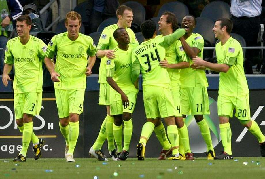 Seattle Sounders FC players celebrate a first-half goal by Roger Levesque against Boca Juniors of Argentina at Qwest Field in Seattle on Wednesday. May 26, 2010. The Sounders led 1-0 at the half. Photo: Joshua Trujillo, Seattlepi.com / seattlepi.com