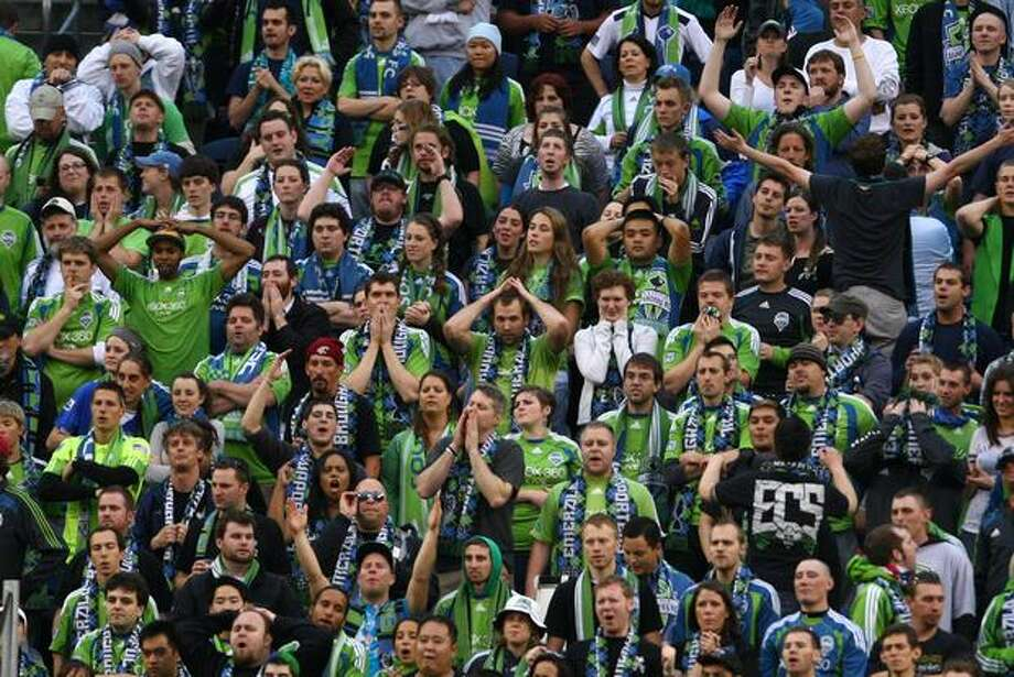 Seattle Sounders fans react after the second D.C. United goal during the first half of an MLS soccer match at Qwest Field in Seattle on Thursday, June 10, 2010. Photo: Joshua Trujillo, Seattlepi.com / seattlepi.com