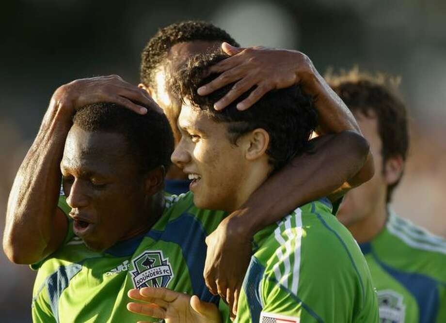 Fredy Montero #17 of the Seattle Sounders FC is congratulated by teammates after he scored a goal against the San Jose Earthquakes at Buck Shaw Stadium on July 31, 2010 in Santa Clara, California. Photo: Getty Images / Getty Images