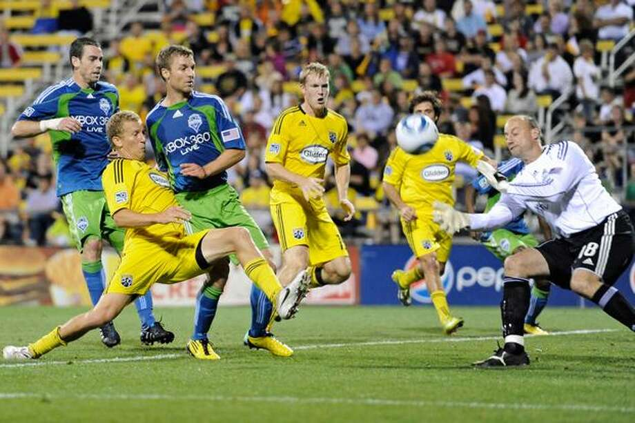 Steven Lenhart #32 of the Columbus Crew redirects the ball toward goalkeeper Kasey Keller #18 of the Seattle Sounders on September 18, 2010 at Crew Stadium in Columbus, Ohio. Photo: Getty Images / Getty Images