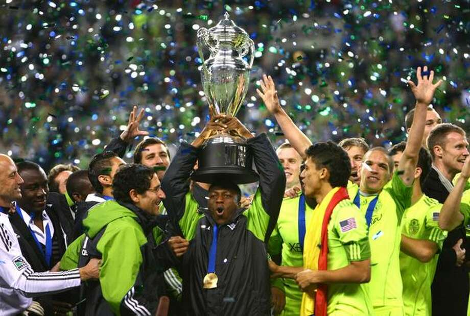 Sounders hero Sanna Nyassi hoists the U.S. Open Cup while surrounded by teammates after defeating Columbus 2-1. Photo: Joshua Trujillo, Seattlepi.com / seattlepi.com
