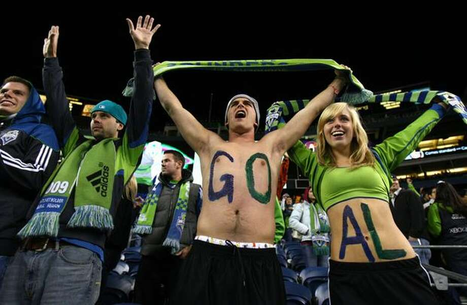 Seattle Sounders fans, from left, Nolan Smith, Charlie Cowin and Katie Walker cheer on their team against Chivas USA on Friday, October 15, 2010 at Qwest Field in Seattle. Photo: Joshua Trujillo, Seattlepi.com / seattlepi.com