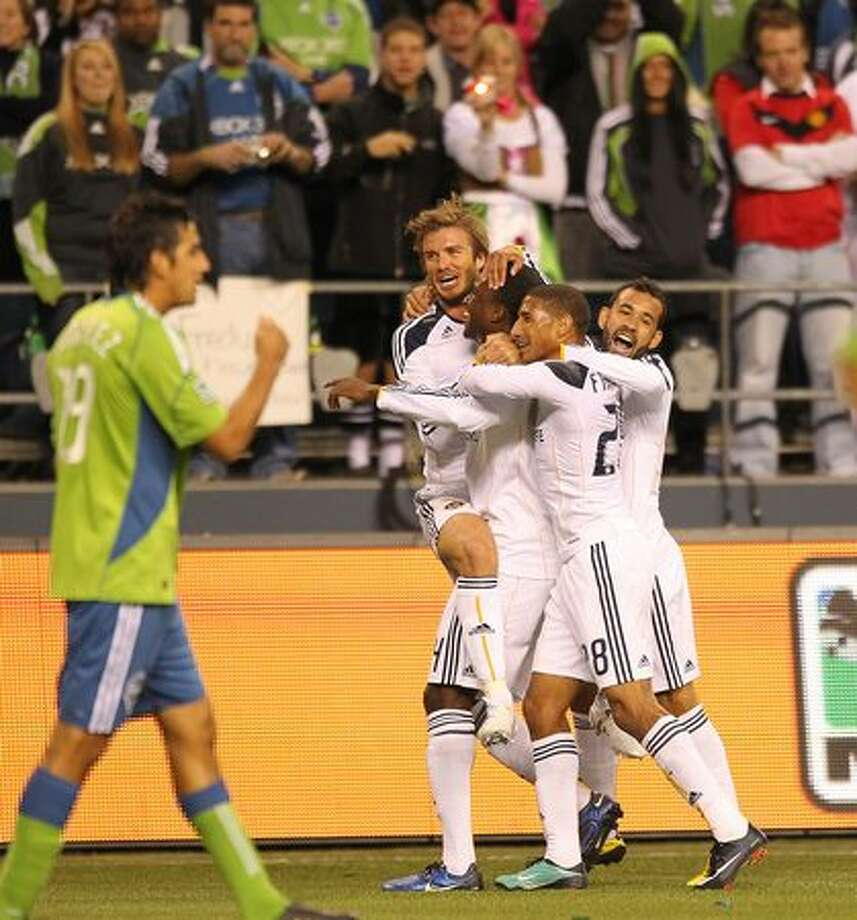 Edson Buddle #14 (third from right) of the Los Angeles Galaxy is congratulated by teammates after scoring a goal in the first half against the Seattle Sounders FC during the first-leg MLS playoff game at Qwest Field in Seattle on Sunday, Oct. 31, 2010. Photo: Getty Images / Getty Images