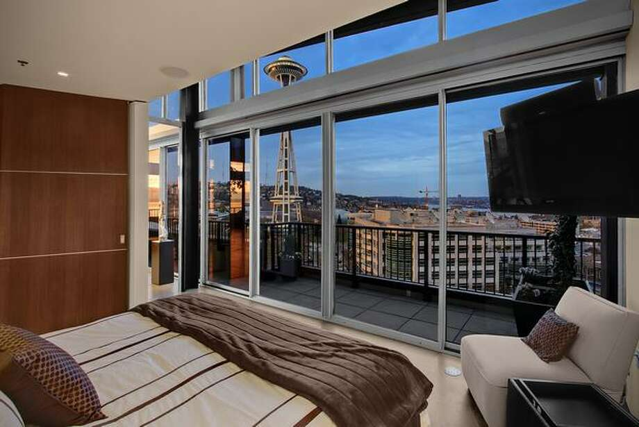Located in Seattle, this penthouse sits atop the Mosler Lofts, offering views of Seattle's Space Needle, Elliot Bay and Puget Sound. It has 2 bedrooms and 2 bathrooms. This home lists at $2,195,000. The penthouse is located at 2720 3rd Ave #PH2. See the listing for more information. (Windermere)