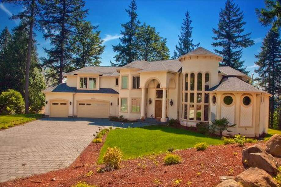 Located in Issaquah, this home sits on a 63,399 square foot lot.  It also offers a master suite with a fireplace, jacuzzi tub, wet bar, media room, rec room & bonus and sprinkler system. This 4-bedroom and 5-bath house lists at $1.95 million. The house is located at 26239 SE 162nd Place.  See the listing for more information. (Coldwell Banker Bain)