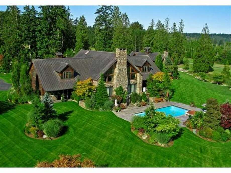 This $7,995,000 home is 7,500 square feet and located in Fall City, which is about 25 miles east of Seattle. It was built in 2000 and has timber framing, a copper roof, four bedrooms and 6.25 baths. There is also a guest house with two bedrooms.  Among its many features are a sauna, weight room, swimming pool -- as well as a poker room. The 80-acre property  includes scenic ponds, bridges, a barn and a pavilion. Oh, and there is also 7-car attached garage. (Windermere.com)