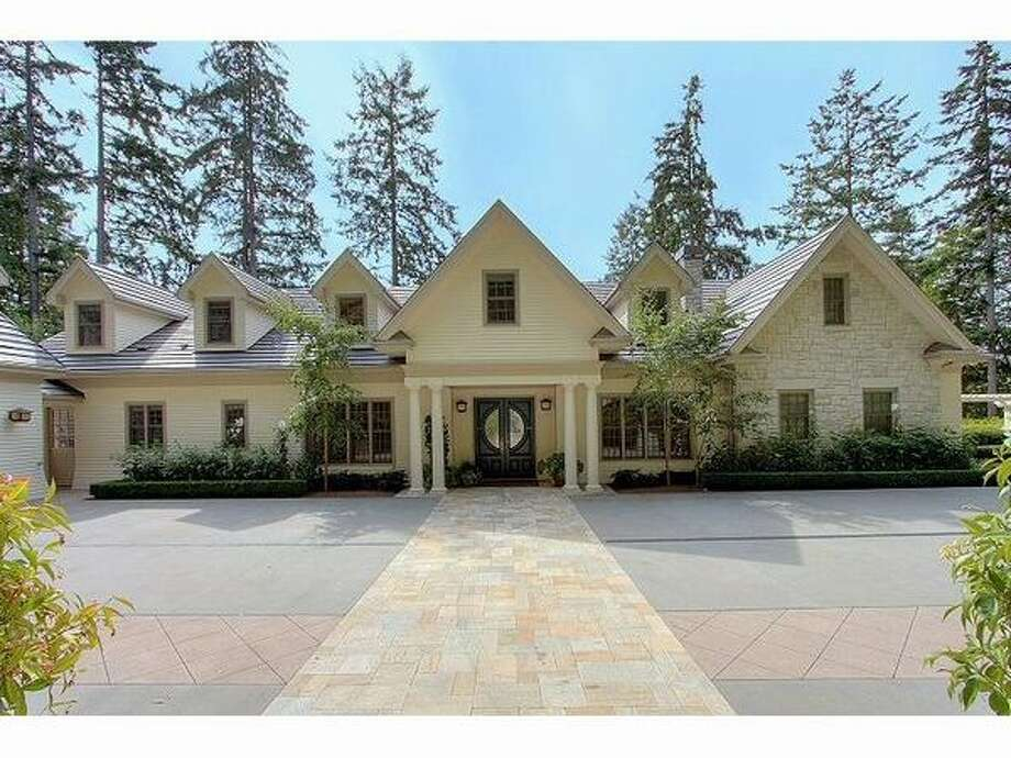 This $3,650,000 Shoreline home is located at 54 Spring Drive NW and is 10,030 square feet.  It has six bedrooms, six bathrooms, a home theater, a temperature-controlled wine cellar, four-car garage and separate guest house. It was built in 2002, has a tile roof and a stone exterior.  Its other features include a large deck, three fireplaces and views of the mountains and the Puget Sound. (Windermere.com)  See the listing.