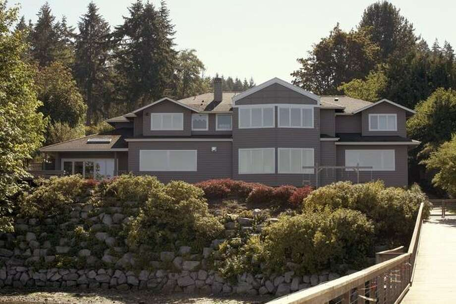 This $3,480,000 home on the waterfront in Eagle Harbor on Bainbridge Island at 5905 NE Rose Loop has 5 bedrooms and 6.5 bathrooms. It was built in 1989 and has 12,300 square feet on one acre of property. (johnlscott.com) See the link.