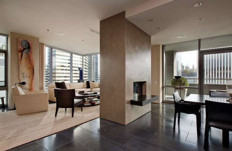 This $1,895,000 downtown condo has two bedrooms and three-and-a-half bathrooms.  It is 2,697 square feet and uses interior materials like granite, Opalescent venetian plaster and honed concrete. (nwgrealestate.com)  See the listing here.
