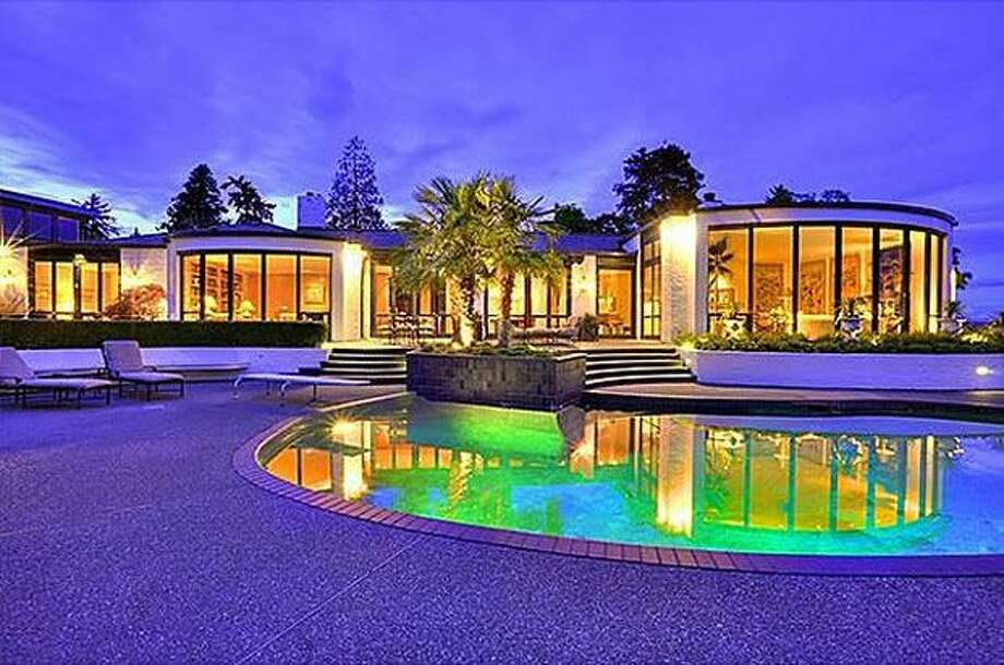 This $7,880,000 home in Washington Park has 3 bedrooms and 4.5 bathrooms and is 5,030 square feet. It offers Beverly Hills glamour on the edge of Lake Washington, with a curving wall of glass that captures the constant change of reflections of water and sky. (wendylister.com) See the listing.