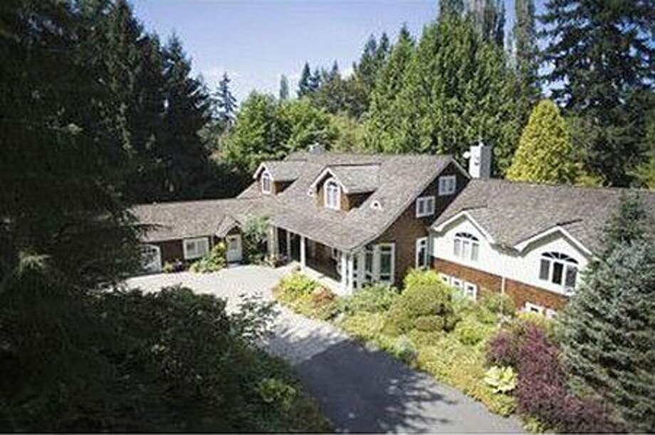 This $4,490,000 home in Redmond with four  bedrooms and 3.5 baths sits on a private, park-like 11.5 acres and was once owned by Eddie Bauer. It is the site of his former hunting lodge. Salmon spawning Bear Creek, towering evergreen trees and expansive green pastures create a majestic and magical backdrop for this sophisticated, graceful and classic custom built home with cedar shingles, covered porch entry, soaring ceilings, warm & rich with extensive use of black walnut and hickory craftsman woodwork. See the full listing here.
