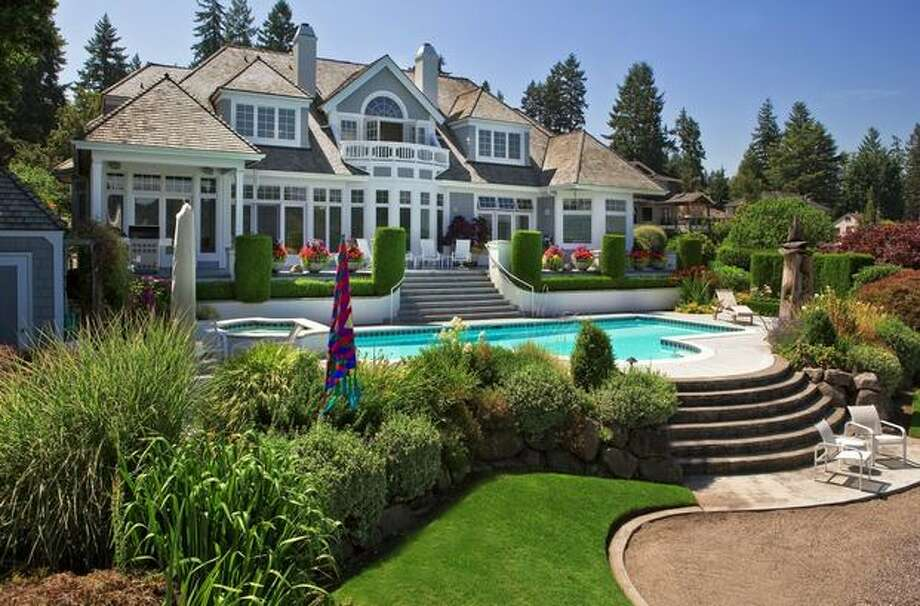 This $3,925,000, four-bedroom, 4.25 bathroom Cape Cod revival on Lake Sammamish is 5,040 square feet of a luxuriously casual, custom waterfront home featuring stunning, distinctive, memorable architecture. It includes honed limestone floors and banks of transom windows on the lakeside. It sits on 110 feet of preeminent, level waterfront and enthusiastically embraces the lakeside lifestyle, with a sandy beach, a boat launch, boat lifts, a seaplane lift, pool and spa. Terrific privacy, with front row expansive lake, mountain and coastline views from nearly every room. See the full listing here. (John L. Scott)