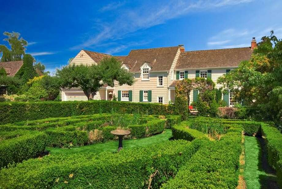 This $3,885,000 estate in South Seattle was built in the 1920s and rests on a stretch of manicured grounds with 100 feet of level waterfront. the home features a formal boxwood garden, large day rooms and graceful architectural details. It has five bedrooms and three bathrooms. See the full listing here. (Coldwell Banker)