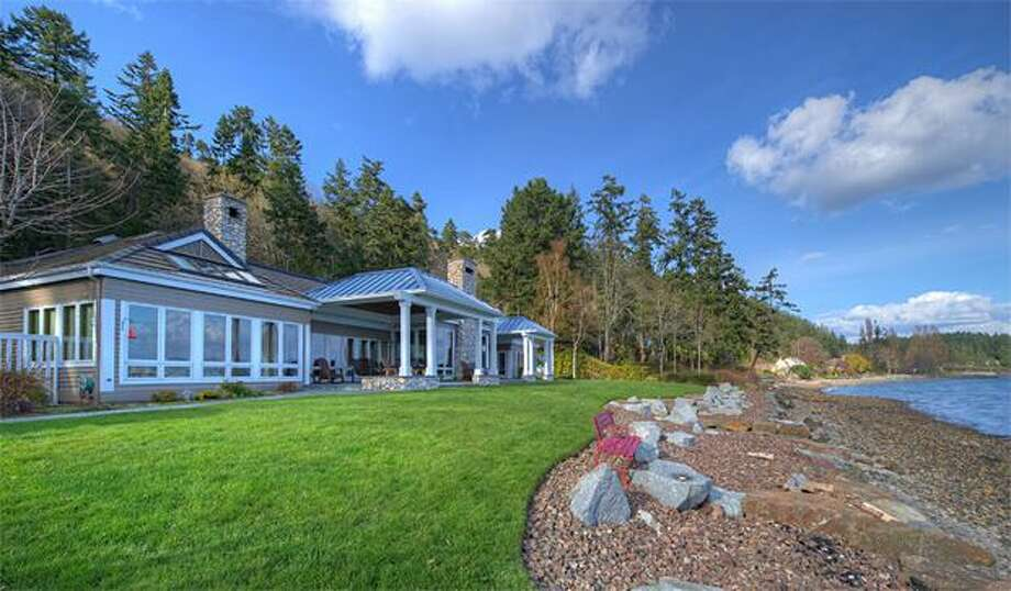 This $4,970,000 Bainbridge Island estate has views of the Seattle Skyline and Mt. Rainier with 154 feet of waterfront and a 5,400-square-foot home. It has 4 bedrooms and 2.5 baths. The property's private gated grounds offer gardens with a conservatory, a gardener's cottage and two covered patios. See the full listing here. (Coldwell Banker)