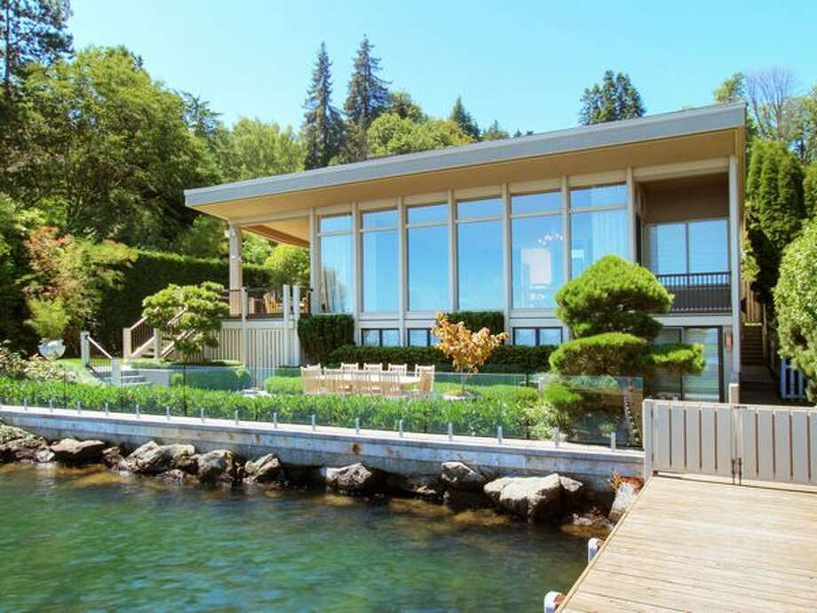 Located on the shore of Lake Washington in the Washington Park neighborhood, this home sits on a 8,505 square foot lot with 81 feet of waterfront.  With floor to ceiling windows, this 3-bedroom house takes advantage of lake and Cascade Mountain views and lists at $7.75 million. The house is located at 400 39th Ave E. See the listing here. (Ewing & Clark)