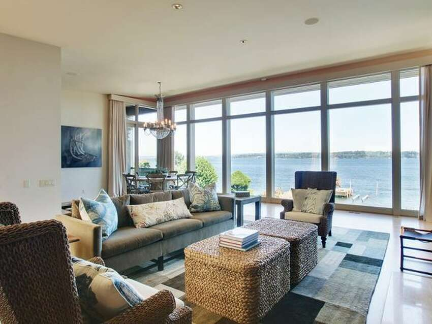 Oak floors, high ceilings and a structured waterfront view highlight the design of the original architects Bain and Overturf. See the listing here. (Ewing & Clark)