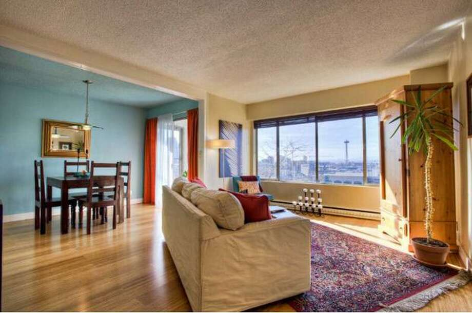 With coffee shops, public parks and a vibrant music scene, Capitol Hill is arguably the coolest neighborhood in Seattle. This gallery features four Capitol Hill one-bedroom apartments on sale for $350,000 or less.   This $159,999 apartment, located at 308 E Republican St. 112, has one bedroom and one bathroom. Built in 1960, this building features an indoor heated pool, rooftop deck and a game room. The living space features large windows.  See the listing.  (Debi Fortin/Windermere)