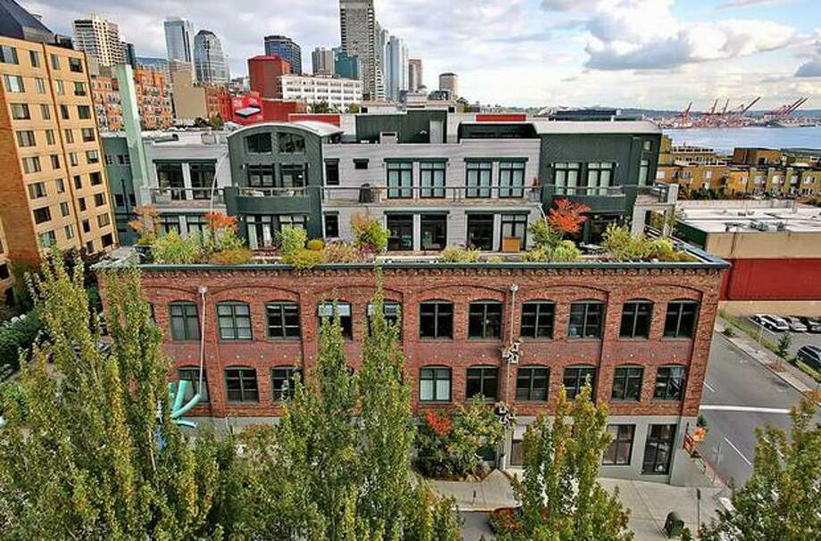 Located near Seattle's waterfront, Belltown is a hip neighborhood with fine dining, art galleries and picturesque parks. This gallery features three Belltown condos under $415,000.    Located at 81 Vine St 306, this condo, listed at $349,500, is located two minutes away from the waterfront. Originally built in 1914, this exposed brick building was renovated in 1999. See the listing.  (Jan Selvar/ Windermere)