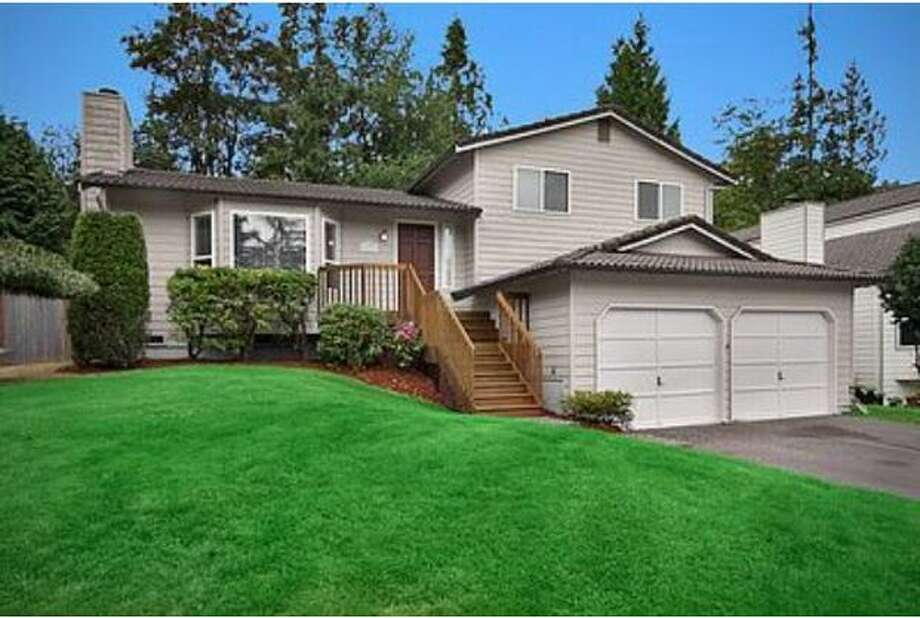 Affordable houses can still be found in the greater Seattle area.  Here are five examples of houses priced at $400,000 or less in areas such as Greenwood, Wedgwood and Bellevue.  This $399,000 home at 16717 SE 40 Place is 1,650 square feet and is located in Bellevue.  It was built in 1985 and has wood siding with a tile roof.  The house includes three bedrooms, 2.5 baths, an attached two-car garage, hot tub, deck and fireplace.  It also has central air conditioning and a sprinkler system.  (Windermere.com)  See the listing here.