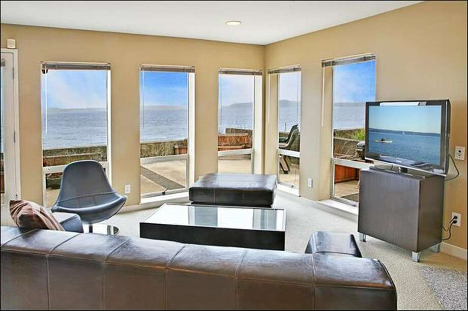 Condos with a waterfront view in Seattle don't come cheap. Here are four condos currently on sale for about $500,000 or less.  This $495,000 condo at 4115 Beach Dr. S.W. near Me-Kwa-Mooks park on Southwest Beach Drive  has two bedrooms and two bathrooms. Built in 1990, this condo has a large patio with a waterfront view and access to the beach.   The living room has a lot of windows to let in daylight and offers a great view of the water.(Windermere.com) See the listing.
