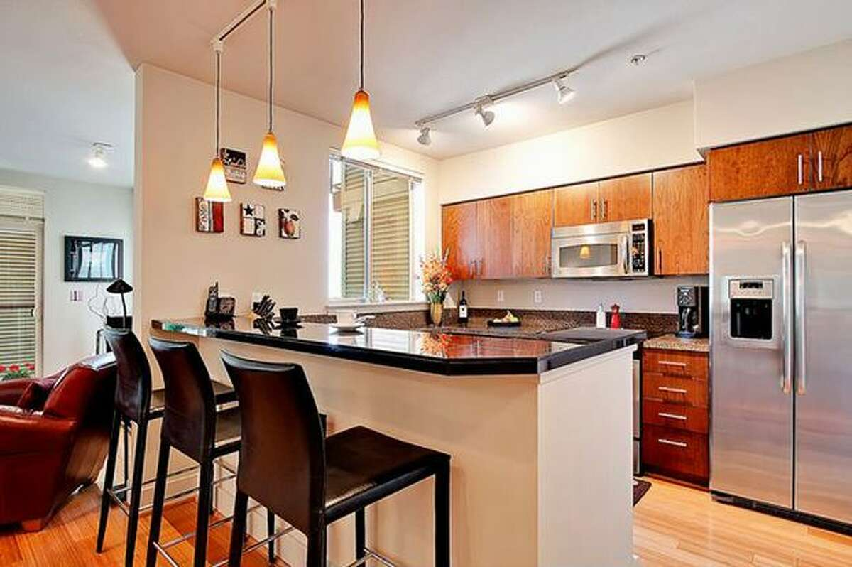 The kitchen has stainless steel appliances and slab granite counters. (Windermere.com) See the listing