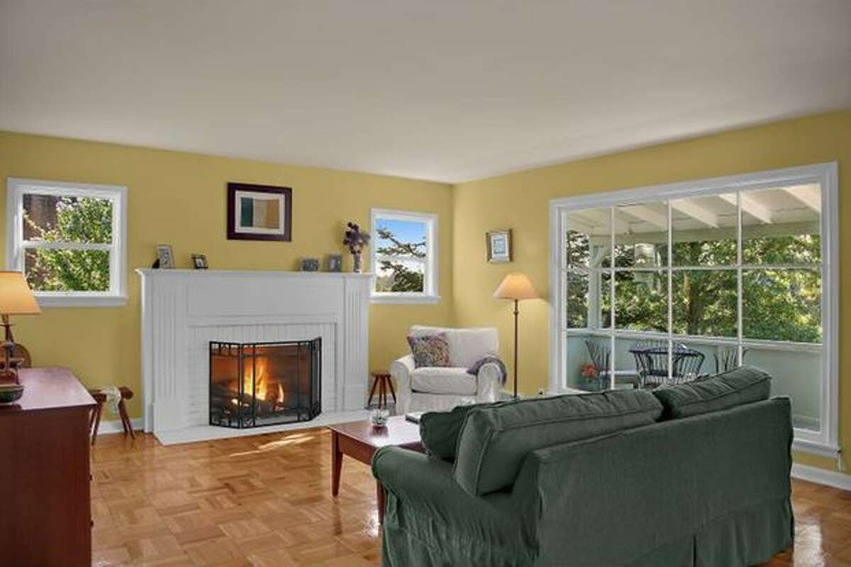 The upstairs living area has a fire place and large windows. (Windermere.com) See the listing.
