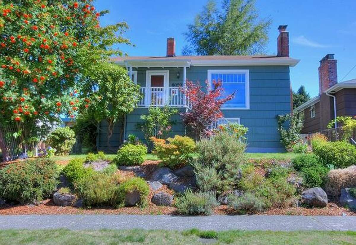 This in Ballard has two bedrooms and 1.75 bathrooms. Built in 1931, this 1,640 square foot house has a backyard, garden beds and a basement that can function has a mother-in-law apartment..