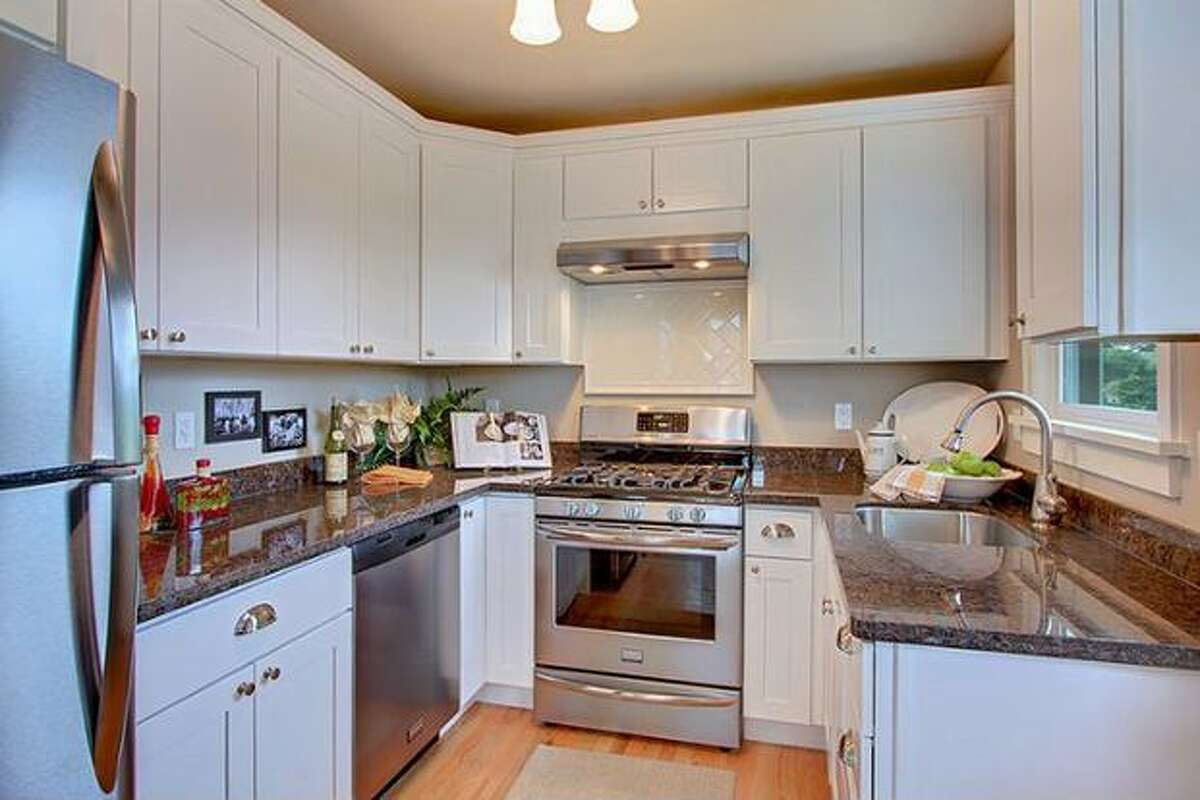 The kitchen has slab granite counters and stainless steel appliances. (Windermere.com) See the listing.