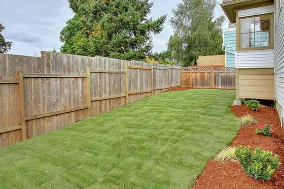 The house has a partially fenced backyard. (Windermere.com) See the  listing .
