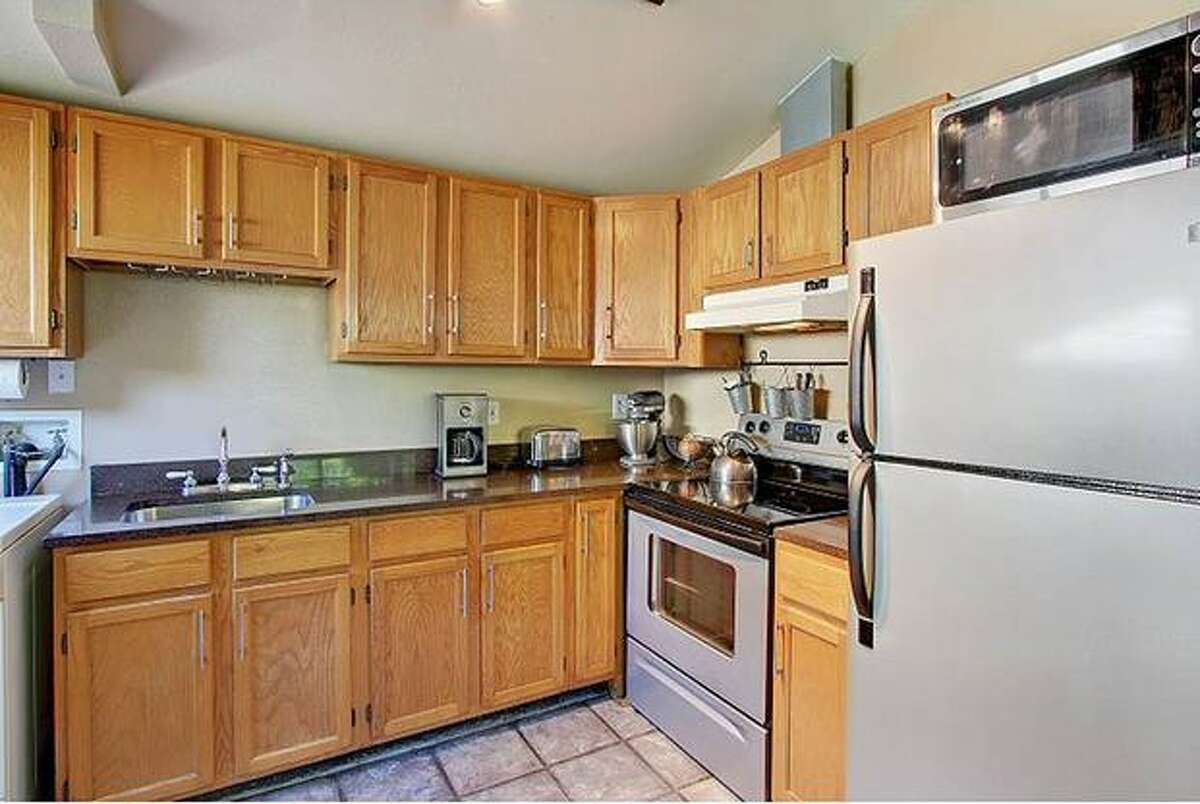 The kitchen has granite counters and new appliances. (Windermere.com) See the listing.